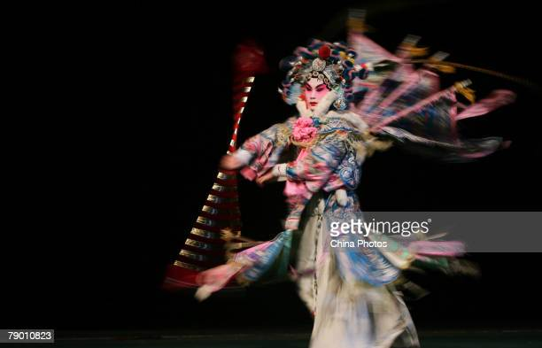 A student from the Peking Opera Department of the Jilin College of the Arts performs Peking Opera's Fortified Village Muke on January 15 2008 in...
