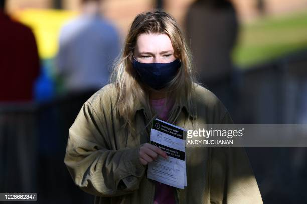 Student from the University of Glasgow walks at a pop-up testing centre for the novel coronavirus Covid-19 at the Murano Street Student Village...