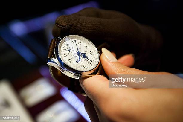 A student from Tourneau Inc's Watchmaker Program resets a Longines watch manufactured by Cie des Montres Longines Francillon SA ahead of Daylight...