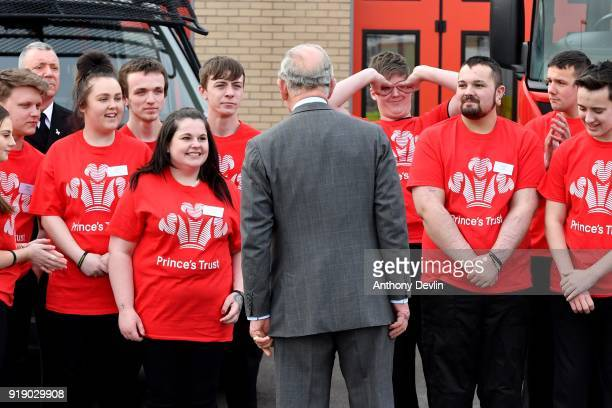 A student gestures as The Prince of Wales poses for a group photograph with staff and students during a visit to Dearne Community Fire Station on...
