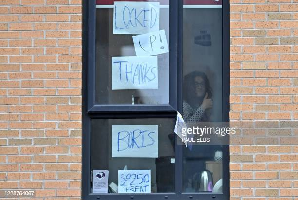 Student gestures at the window of the Birley Halls student accommodation, for students at Manchester Metropolitan University, in Manchester,...