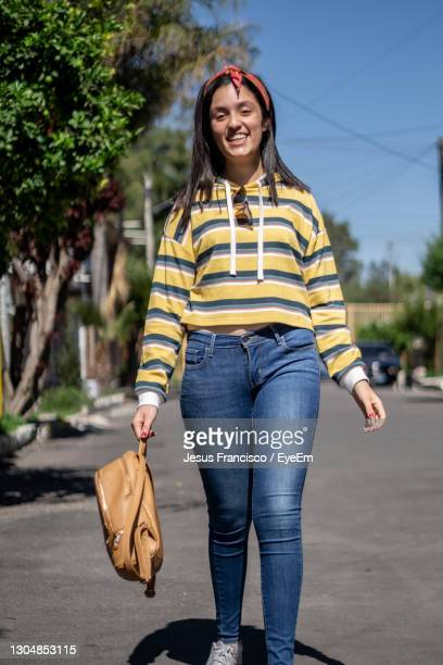 student girl in a trendy clothes crossing the road. stylish hipster girl wearing oversized - laughing jesus images stock pictures, royalty-free photos & images