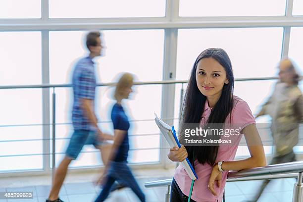 Student girl on stairs in  university