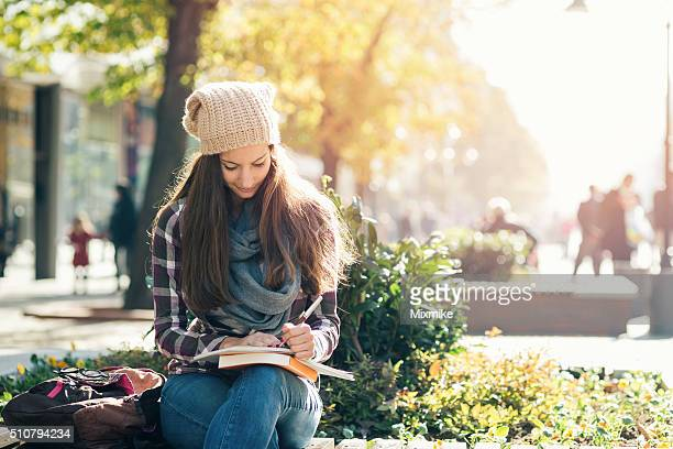 Student girl studying in the campus.
