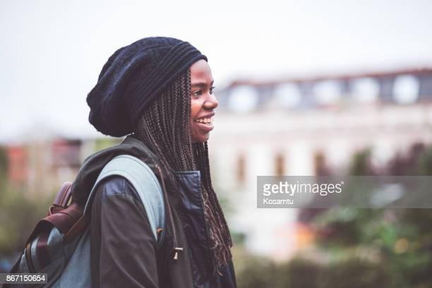 Student Girl Walking Through City Streets