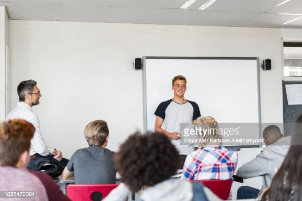 student giving presentation in classroom at class - 18 19 years stock pictures, royalty-free photos & images