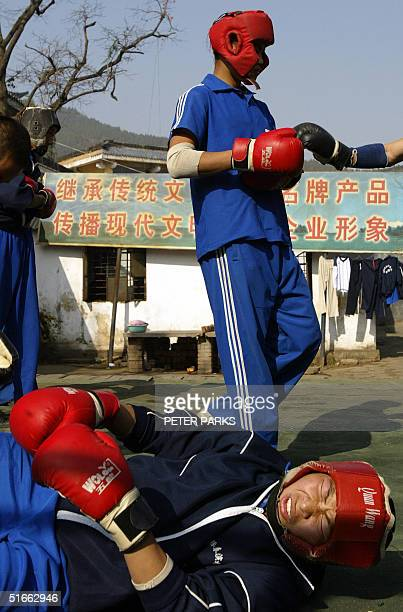 A student grimaces after being knocked down whilst training in the art of Xingyi Quan at the famed Shaolin Monestary in Henan province in central...