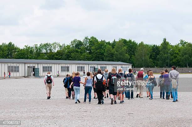 student group visiting dachau concentration camp memorial site - dachau concentration camp stock pictures, royalty-free photos & images