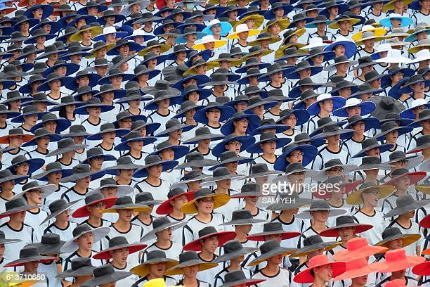 Student groups perform during National Day celebrations in front of the Presidential Palace in Taipei on October 10 2016 Taiwanese President Tsai...