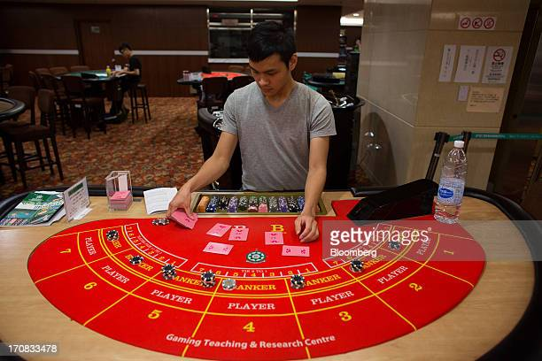 A student handles playing cards while learning the game of blackjack at the Macao Polytechnic Institute Gaming Teaching and Research Centre in Macau...