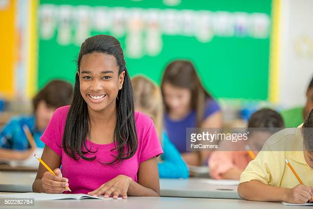 Student Happily Sitting in Class