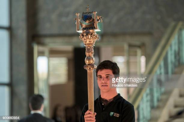 A student hoisting the Universidad de Lisboa symbol opens the ceremony in which UN Secretary General Antonio Guterres received the honorary doctorate...