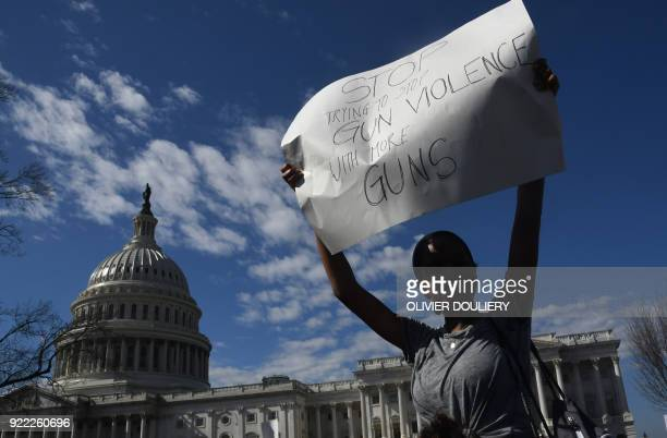 TOPSHOT A student hoists a sign as hundreds of high school and middle school students from the District of Columbia Maryland and Virginia staged...