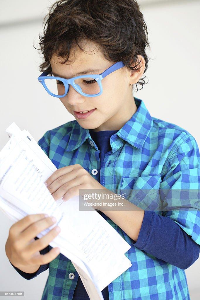 Student holding a test : Bildbanksbilder