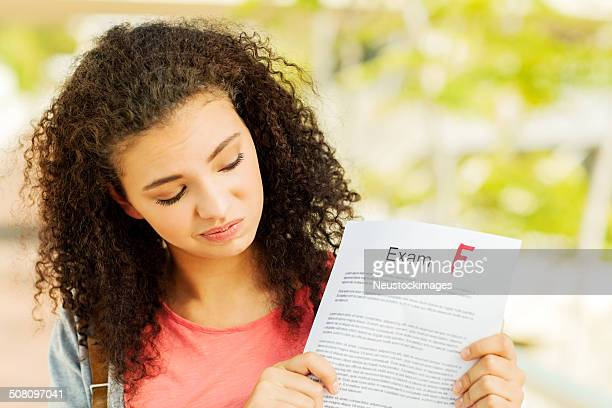 Student Holding Exam Result With F Grade On Campus
