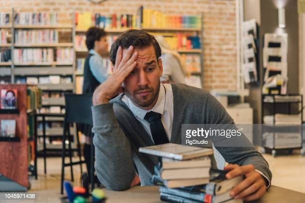 Student holding hand on his head when studying