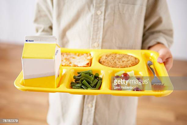 student holding lunch tray - milk carton stock photos and pictures