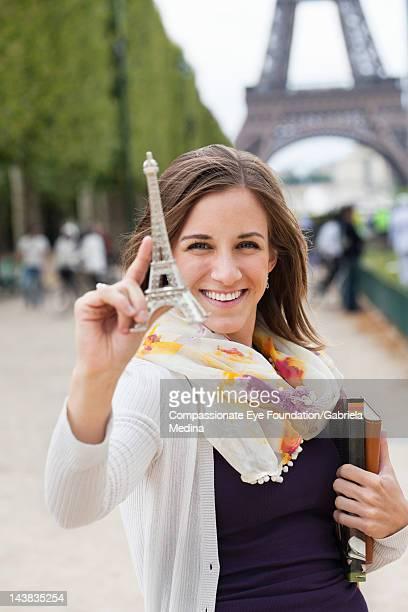 Student holding souvenir Eiffel Tower