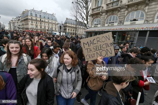 A student holds a banner reading quotMacron your selection its no » as he takes part in a rally to protest against a proposed reform of the...