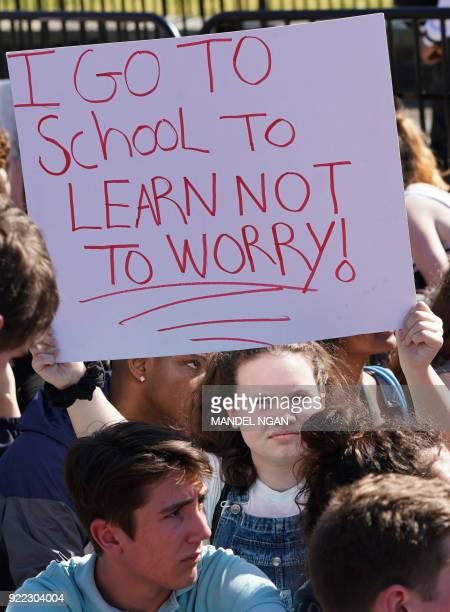 A student holds a placard as hundreds of high school and middle school students from the District of Columbia Maryland and Virginia staged walkouts...
