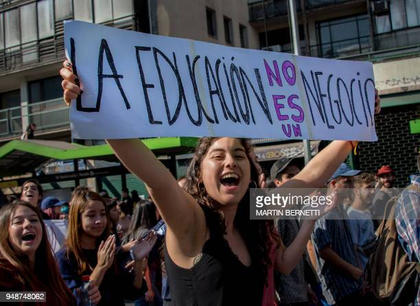 A student holds a placard reading 'Education Is Not a Business' as she takes part in a march to protest against the slowness in the progress of the...