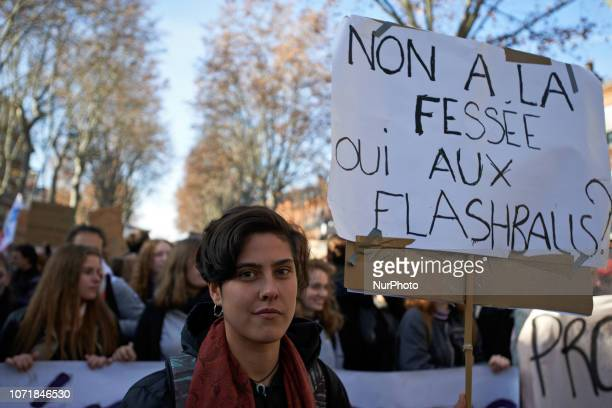 Student holds a placard reading 'No to spanking, yes to flashball ?' in a reference of spanking prohibition by law in France. Highschool students and...