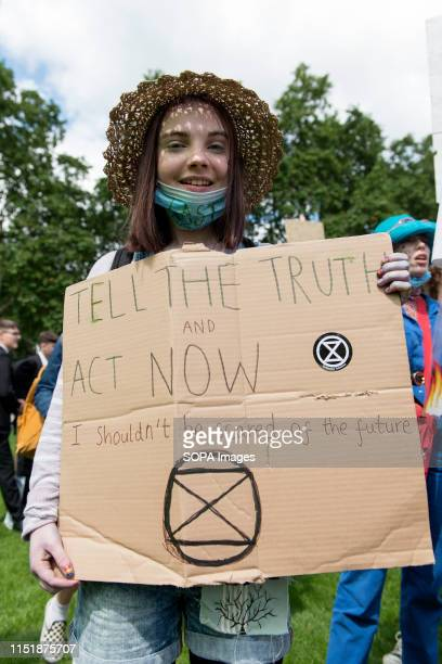A student holds a placard saying Tell The Truth and Act Now at the Parliament Square during a protest Students gathered at Parliament Square and...