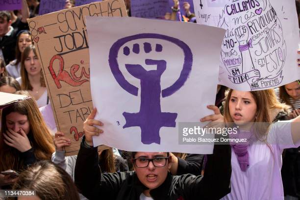 A student holds a placard with feminist symbol during protest along the streets during the International Women's Day on March 08 2019 in Madrid Spain...