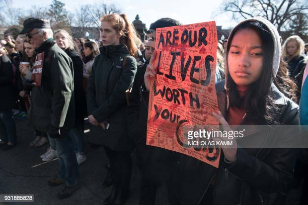 TOPSHOT A student holds a sign at Georgetown University in Washington DC on March 14 2018 during a national walkout to protest gun violence one month...