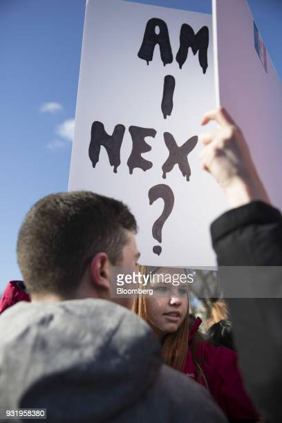 A student holds a sign reading 'Am I Next' outside the White House during the ENOUGH National School Walkout rally in Washington DC US on Wednesday...