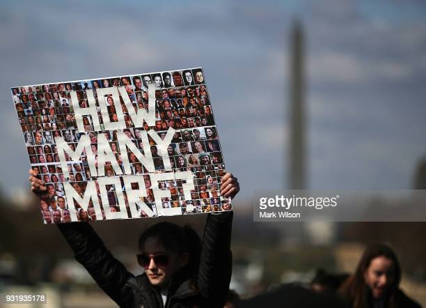 A student holds up a sign during a rally at the US Capitol to urge Congress to take action against gun violence on March 14 2018 on Capitol Hill in...