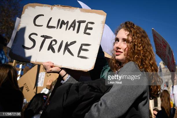 A student holds up her placard as a group gathers in Parliament Square during a climate protest on February 15 2019 in London United Kingdom...