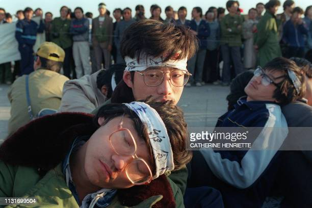 Student hunger strikers from Beijing University relax 14 May 1989 as several hundred students stage a huge demonstration at Tiananmen Square as they...