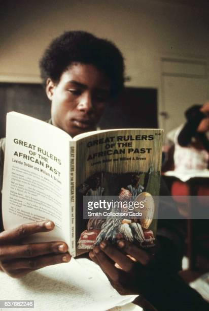 A student in a black studies class reading a book titled 'Great Rulers of African Past' West Side Chicago Illinois October 1973 Image courtesy...