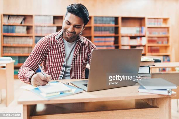 student in a library - indian ethnicity stock pictures, royalty-free photos & images