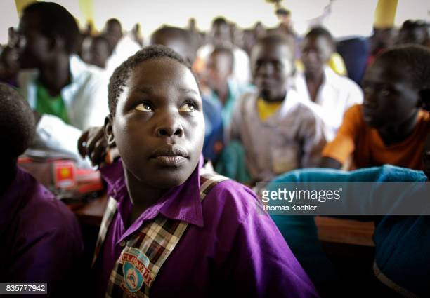 Student in a school at the Rhino Refugee Camp Settlement in northern Uganda Here children of local people and refugees are taught together The area...