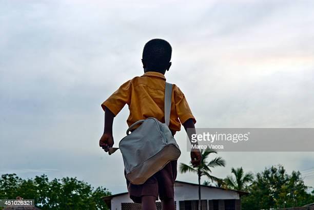 student in africa rushing for school - ghana africa fotografías e imágenes de stock