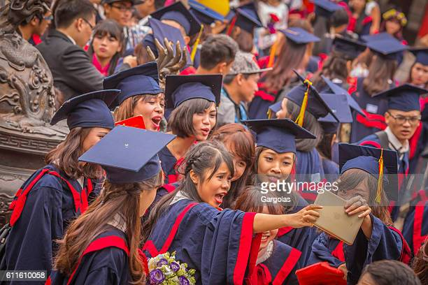 student in gown, graduate ceremony - graduation crowd stock pictures, royalty-free photos & images