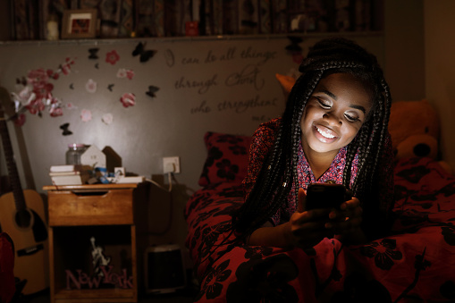 Student in room an phone at night - gettyimageskorea