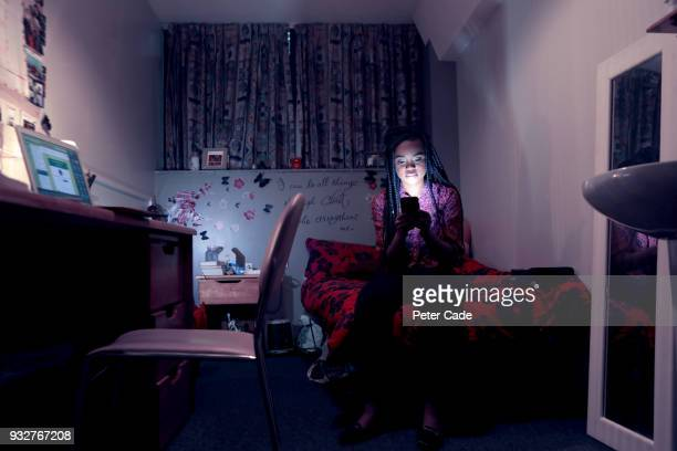 student in room, on phone, at night - bullying stock pictures, royalty-free photos & images