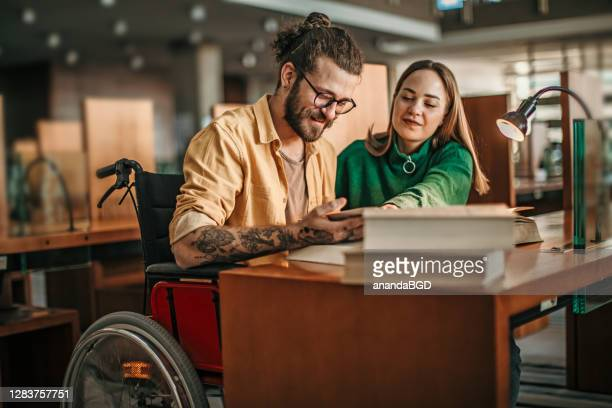 student in wheelchair - physical disability stock pictures, royalty-free photos & images
