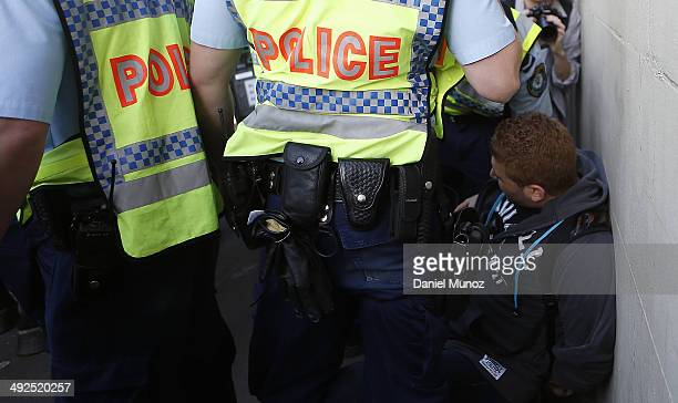 A student is arrested during a protest against government cuts in education on May 21 2014 in Sydney Australia Student activists gathered today in...