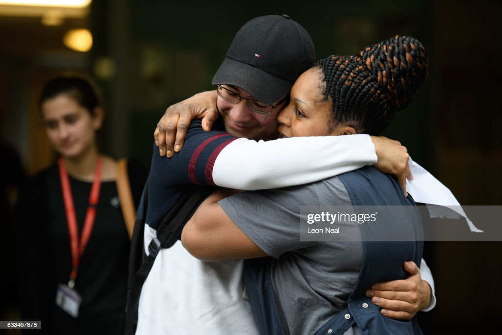 A student is congratulated after receiving his A level results at City and Islington College on August 17, 2017 in London, England. The number of students receiving the highest grades of A and A* grades has increased for the first time in six years.