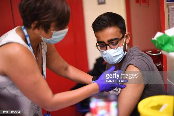 Student is given a dose of the Pfizer/BioNTech Covid-19 vaccine at a vaccination centre at the Hunter Street Health Centre in London on June 5, 2021....