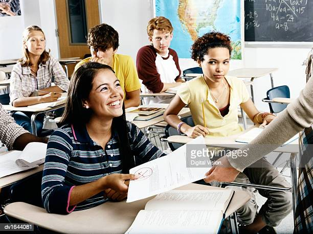 a student is given back her exam results, while members of the class look on - high school musical: the musical: the series stock pictures, royalty-free photos & images