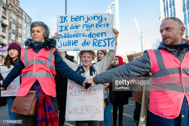 A student is holding a placard during the demonstration for better climate policy in Brussels on February 14th 2019