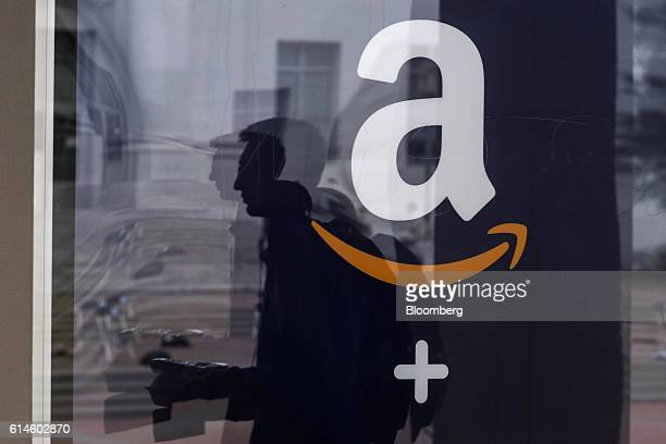 A student is reflected in the window of an Amazoncom Inc kiosk on the University of California Berkeley campus in Berkeley California US on Wednesday...