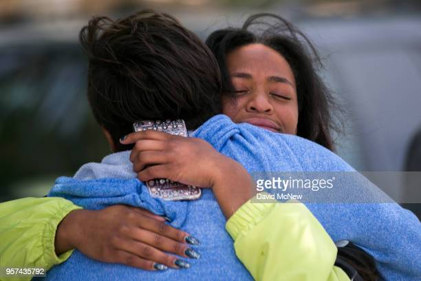 A student is reunited with friends and family after a shooting at Highland High School on May 11 2018 in Palmdale California A 14yearold male student...