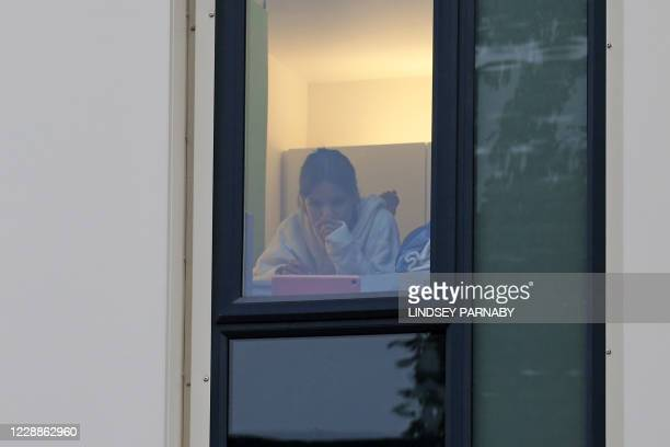 Student is seen at the window in a halls of residence for students in Newcastle-upon-Tyne, north-east England on October 3 as many students...