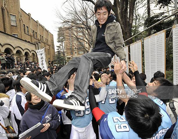 Student is tossed into the air to celebrate his successful entrance exam results at Tokyo University in Tokyo on March 10, 2008. Tokyo University,...